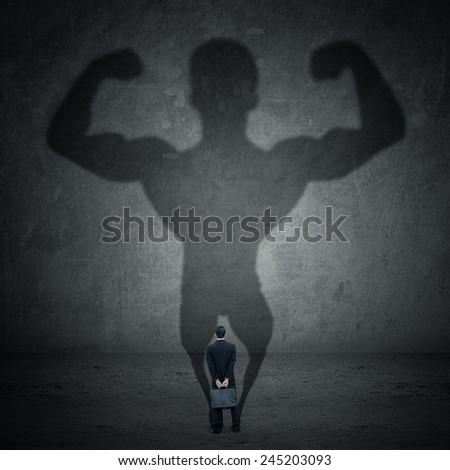 Business man casting a shadow of an athlete - business and career strength concept