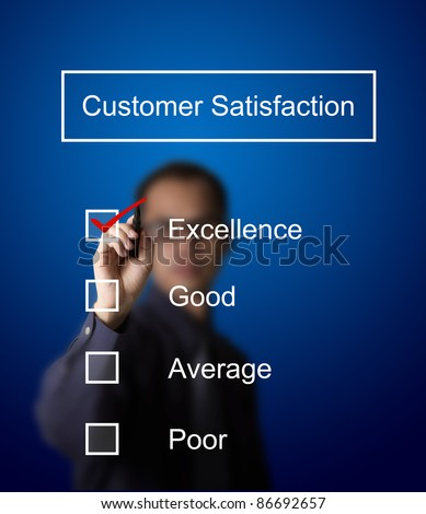 business man checking  excellence on customer satisfaction survey form