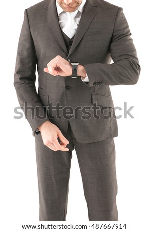 Business man checking his watch, on a white background, stock picture