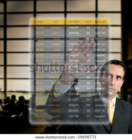 Business man choosing his flight at the airport on a digital futuristic display