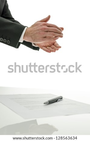 Business man clapping over a signed contract. Concept of successful business.