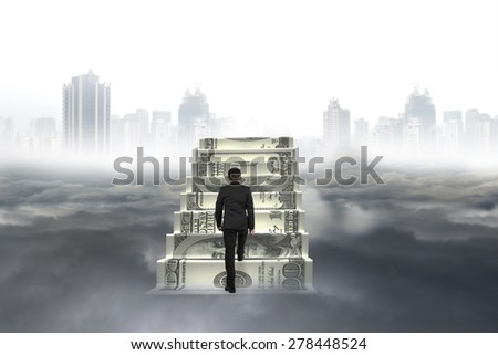 Business man climb on money stairs with city landscape gray cloudscape background - stock photo