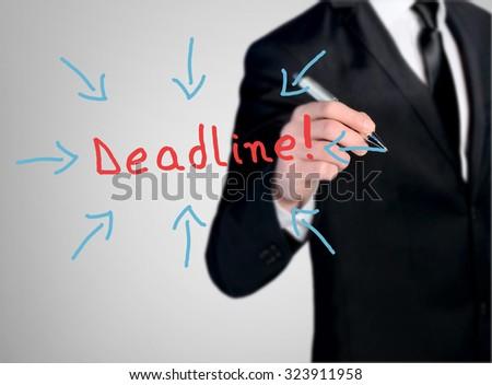 Business man close-up write Deadline word - stock photo