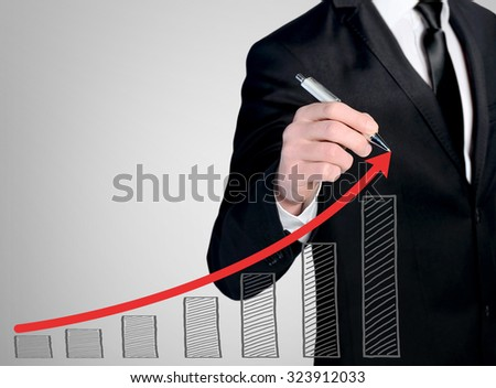 Business man close-up write success chart