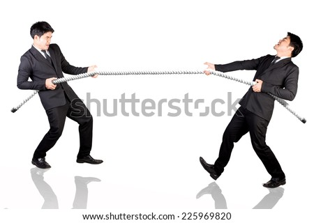 Business man concept of competition tug of war with himself  - stock photo