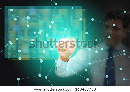 Business man connecting various business points of network, people and operating through a virtual Circuit board - stock photo