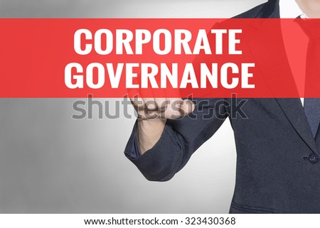 Business man Corporate Governance word touching on red tab virtual screen for business concept - stock photo