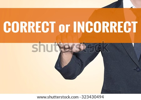 Business man CORRECT or INCORRECT word touch on virtual screen orange background - stock photo