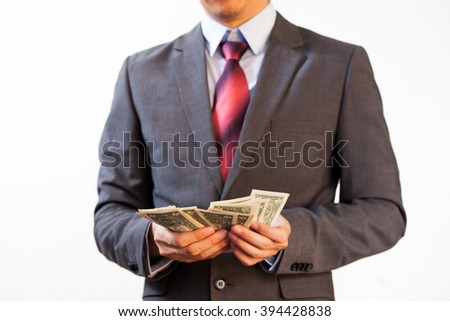 Business man counting money on white isolated background