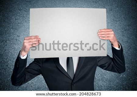 Business man cover face with empty board