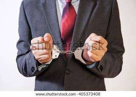 Business man criminal handcuffed - Business criminal, debt, burden concept - stock photo