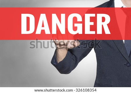 Business man Danger word touching on red tab virtual screen for business concept - stock photo