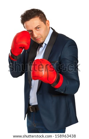 Business man defending and wearing boxing gloves isolated on white background