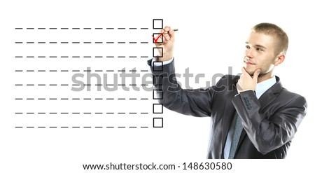 business man designed on a checklist box. With red checklist - stock photo