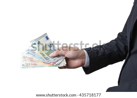 Business Man Displaying a Spread of Cash over isolated a white background, have clipping path.