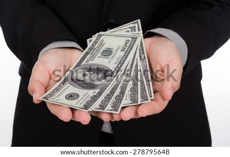 Business man Displaying a Spread of Dollar - stock photo