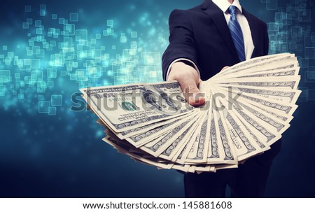 Business Man Displaying Spread of one hundred dollar bills - stock photo