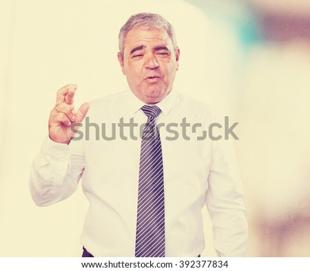 business man doing a luck gesture