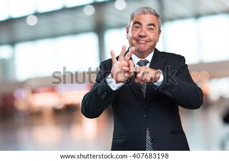 business man doing a sex gesture - stock photo
