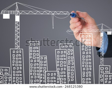 Business man draw building and cityscape. Construction site concept.  Isolated on grey. Stock Image - stock photo