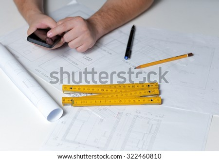 Business man draw buildings and present his architectural project