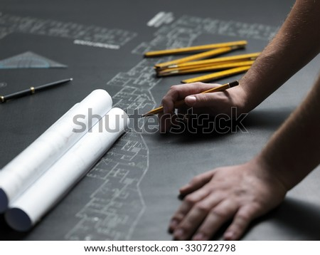 Business man draw buildings and present his architectural project, art content - stock photo