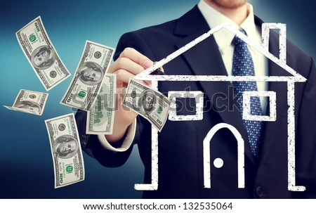 Business man drawing a house illustration and flying hundred dollar bills - stock photo