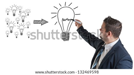 Business man drawing an creativity concept on a whiteboard - stock photo