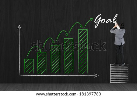 Business man drawing business growing green graph for success - stock photo