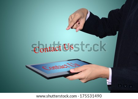 Business man drawing Contact Us concept .  - stock photo