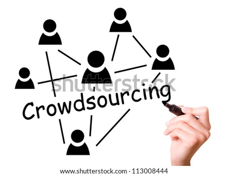 Business man drawing crowd sourcing concept to screen. - stock photo