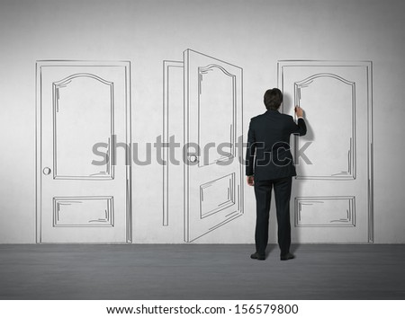 business man drawing doors on the wall