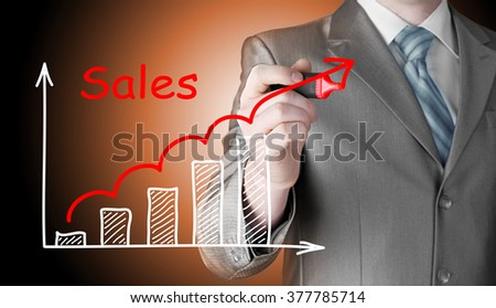 business man drawing graph of sales