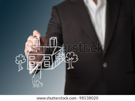 Business man drawing house with tree and family - stock photo