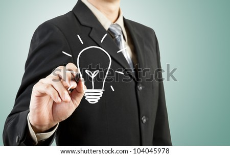 business man drawing light bulb idea - stock photo