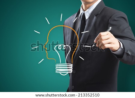 Business man drawing light bulb metaphor for good idea, Inspiration concept - stock photo