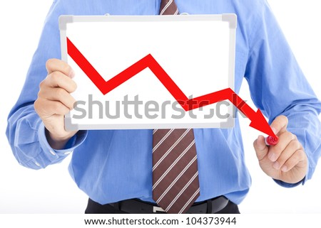business man drawing red down graph on the whiteboard - stock photo