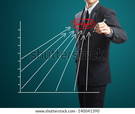 Business man drawing success chart - stock photo