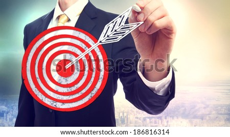 Business man drawing target with chalk - stock photo