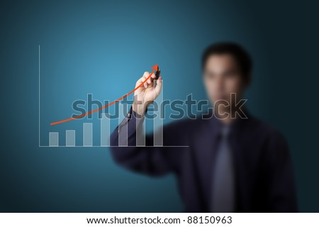 business man drawing upward trend graph on white board - stock photo