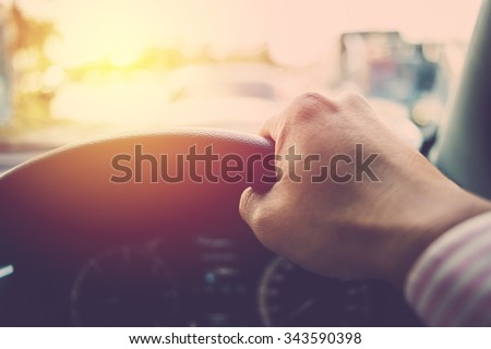 Business man driving car. Vintage filter. - stock photo