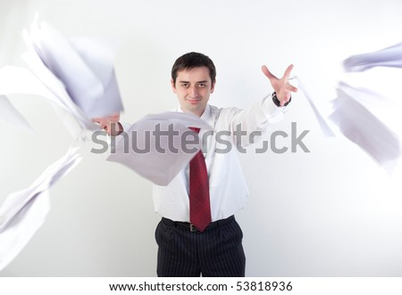 Business man dropping documents