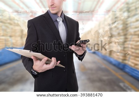 Business man during Communicate export and import goods prepare the delivery of powder bag in warehouse  (Elements of this image furnished by NASA) - stock photo