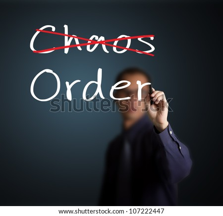 business man eliminate chaos and make order