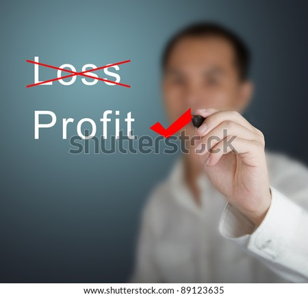 business man eliminate loss and choose profit - stock photo