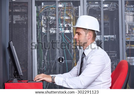 business man engeneer in modern datacenter server room