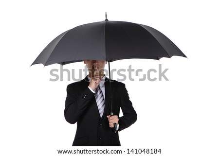 Business man finger on lips asking for silence with umbrella