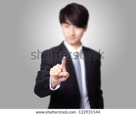 Business Man finger pushing on a touch screen interface, great for you add any creativity text or image, asian model - stock photo