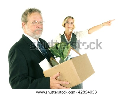Business man fired by a business woman - stock photo