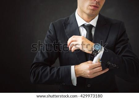 Business man fixing his shirt - stock photo